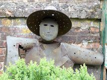Iron scarecrow standing against garden wall at Chenies Manor House stock image