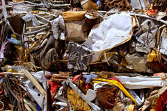 Iron scrap metal compacted to recycle. Green process ecology industry Stock Photos