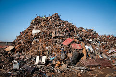 Iron scrap metal compacted to recycle. Green process ecology industry Royalty Free Stock Image