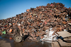 Iron scrap metal compacted to recycle Stock Photos