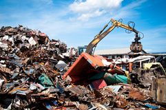 Iron scrap metal compacted to recycle. Green process ecology industry Royalty Free Stock Photos