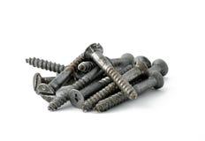 Iron screws. Stack of iron screws on white background Stock Images