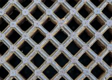 Iron sewer grate background. Iron gray sewer grate as a background Stock Image