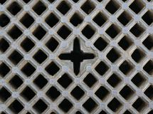 Iron sewer grate background. Iron gray sewer grate as a background Stock Photo