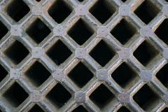 Iron sewer grate background. Iron gray sewer grate as a background Stock Photos