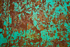 Iron sheet with rust. Color painted iron sheet with rust as background Royalty Free Stock Photos