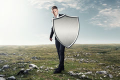 Iron shield. Man with an iron shield Royalty Free Stock Images