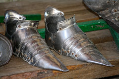 The iron shoes of the knight. On the stand Stock Image