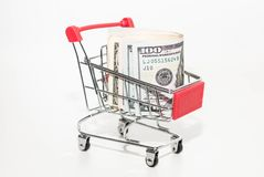 Iron shopping basket with money. Food basket royalty free stock photos