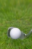 Iron shot, ball in flight Stock Photos