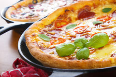 Iron skillet pizzas Stock Images