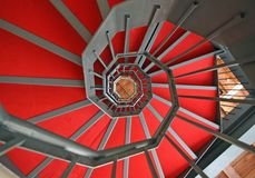 Spiral staircase with elegant red carpet and spiral Stock Photo