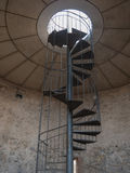 Iron spiral stairs in old tower Royalty Free Stock Image