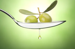Iron Spoon with olive Stock Images