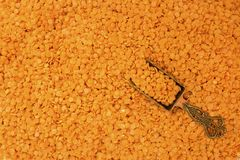 Ä°ron spoon with red lentil background. stock photography