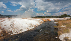Iron Spring Creek and Cliff Geyser in Black Sand Geyser Basin in Yellowstone National Park in Wyoming USA Royalty Free Stock Image