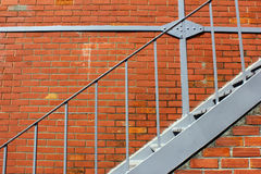 Iron stairs and a brick wall Stock Photo