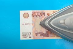 The iron stands on Russian monetary currency Stock Image