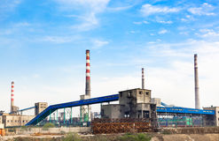 Iron and steel plant appearance. A small iron and steel plant and the huge chimney Stock Image