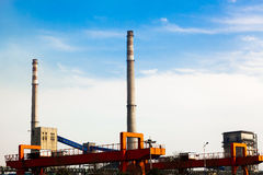 Iron and steel plant appearance. A small iron and steel plant and the huge chimney Stock Images