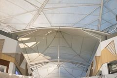 An iron/steel roof system, stretched membrane steel roof. Structure details and connection system stock image