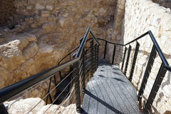 Iron steps. And ruins in Tel Arad, Israel Stock Image