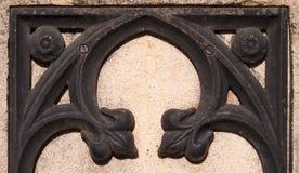 Iron on stone decorative detal. Iron on stone decorative detail of a wall Stock Photos