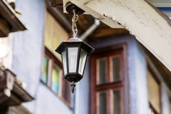 Iron Street Lantern with energy saving bulb. Vintage Street Lantern with energy saving bulb stock image