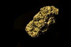 Iron sulphide. On black background. Isolated. Similar like gold Stock Image