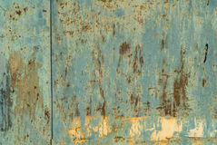 Iron surface is covered with old paint texture background Stock Photos