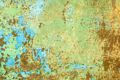 Iron surface is covered with old paint texture background Stock Images