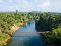 Iron suspension bridge for cross the river. Bridge stock photos