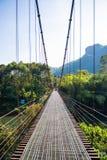 Iron suspension bridge for cross the river. Bridge royalty free stock photography