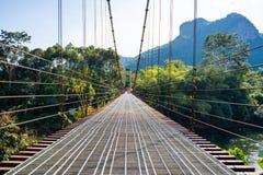 Iron suspension bridge for cross the river. Bridge stock image
