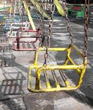 Iron swing. Old iron swings in playground Royalty Free Stock Photos