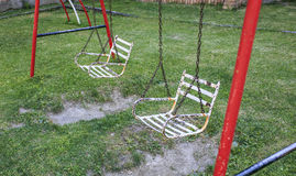 Iron swing seat in a park.  Stock Photo