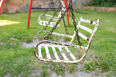 Iron swing seat in a park.  Stock Photos