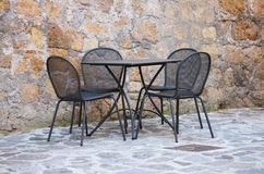 Iron table and chairs Royalty Free Stock Photography