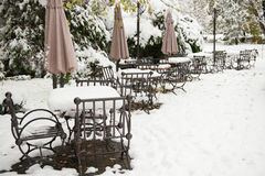 Iron table and chairs covered with snow Royalty Free Stock Photo
