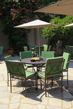 Iron tables and chairs in beautiful patio Royalty Free Stock Photo