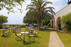 Iron tables and chairs in the garden,Greece Stock Photography