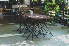 Iron tables and chairs wood Royalty Free Stock Photos