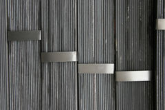 Iron tape. Vertically combined steel drawn by an iron tape Royalty Free Stock Image