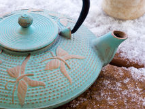 Iron teapot on snow covered deck Royalty Free Stock Images