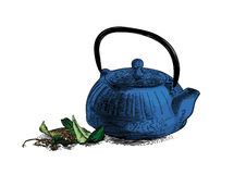 Iron teapot with tea leaves Stock Photo