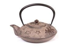 Iron teapot on white background. Royalty Free Stock Photo