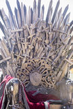 Iron throne made with swords, fantasy scene or stage. Recreation Royalty Free Stock Images