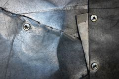 Iron tin with seams and screws Stock Photo
