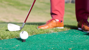 Iron to ball and takes aim. At the golf course royalty free stock photos