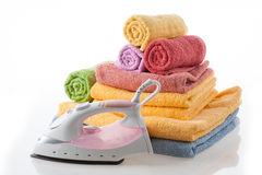 Iron and towels Royalty Free Stock Photos